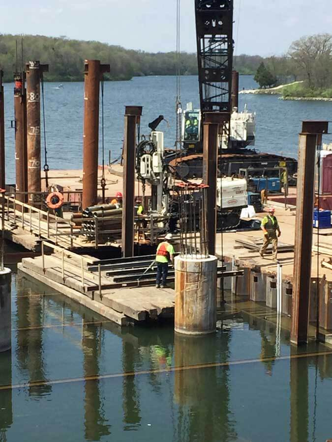 The Field Team for Major Drilling in Salt Lake City, UT, was actually not in the field but on the water for the installation of de-watering wells inside a cofferdam near Des Moines, IA. The goal of the work was to relieve any hydrostatic pressure that may exist.