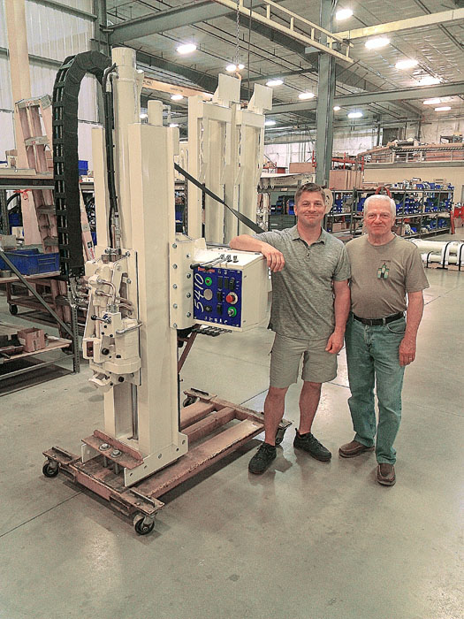 Rob and his father, Bob McAllister, spend some get-acquainted time in Geoprobe® Assembly with the new 5410 unit that will be installed in Rob's new Silver Ford F350.