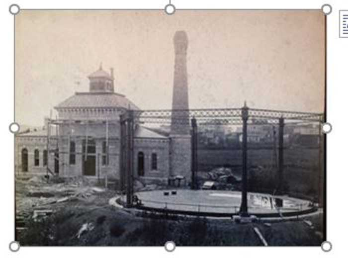 The Wellington, KS, Manufactured Gas Plant (MGP) under construction circa 1886.  Note the gas holder in the right foreground.  It was destroyed and backfilled after the plant closed.