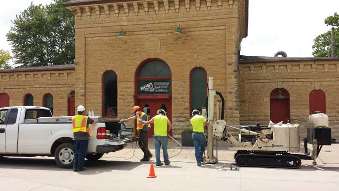 Members of GSI Engineering of Wichita, KS, and the Kansas Department of Health & Environment (KDHE) run an OIP-G log in front of the former Manufactured Gas Plant (MGP) building in Wellington, KS, which has been converted to a railroad museum.