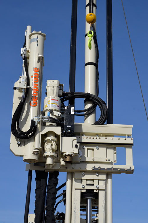 Slide automatic drop hammer into position using control panel on 3126GT drilling truck.