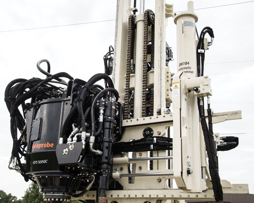 GV5 sonic drilling rig head includes centerline head side shift to position inside the tool string without moving mast or machine