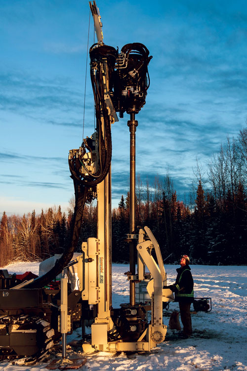 8150LS drills at -38 degrees Fahrenheit in alluvial sands and gravels of the Tanana Basin near Fairbanks, Alaska. Mobilized, complete with rod handler and GV5 50K sonic head, in a 40-foot container to investigate distribution of permafrost and install well clusters to evaluate vertical hydraulic gradients.