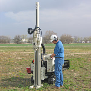 54LT mini drill rig uses direct push for environmental sampling